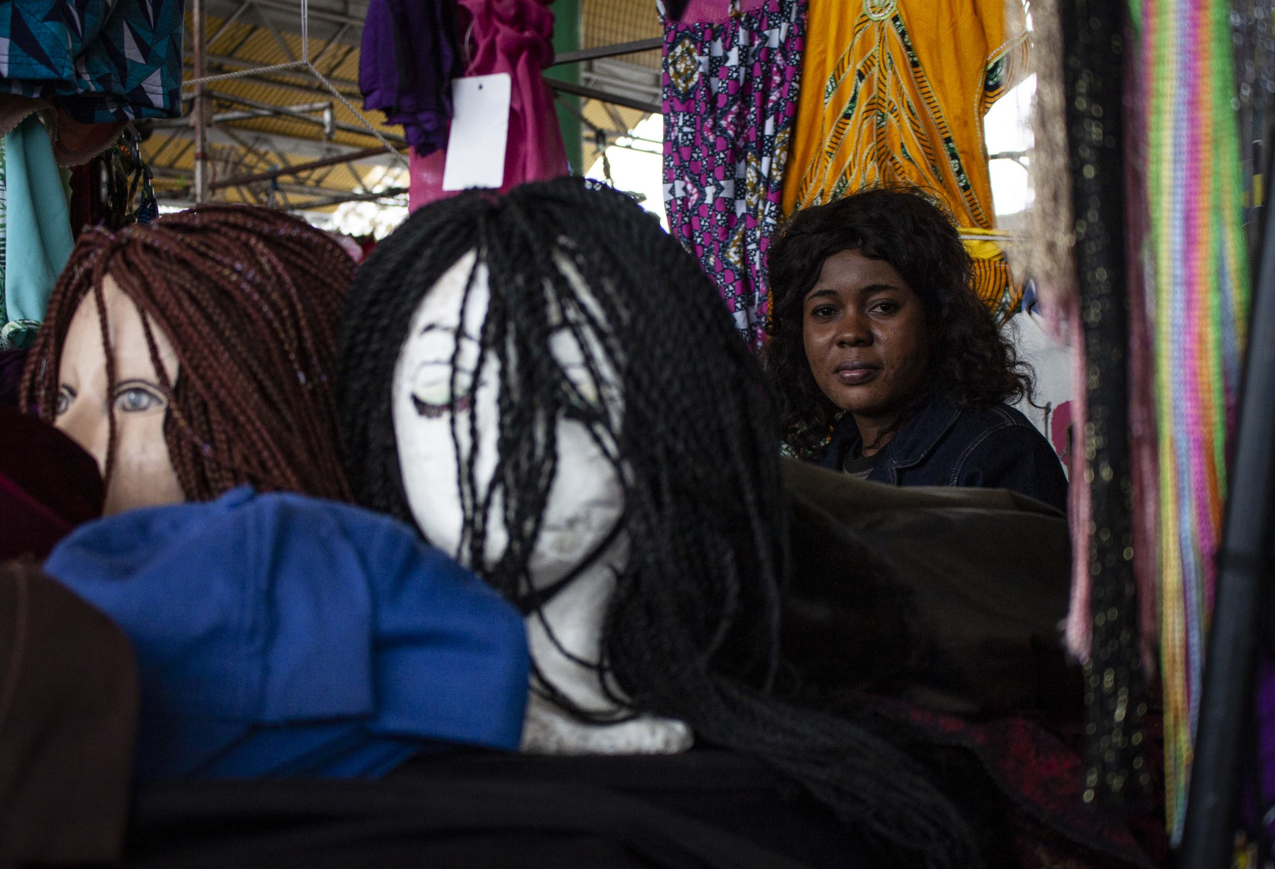 Charlene at her market stall in Bellville, Cape Town. Suggested Credit Quentin Pichon/ Scalabrini
